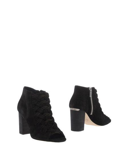 Фото MICHAEL MICHAEL KORS Полусапоги и высокие ботинки. Купить с доставкой